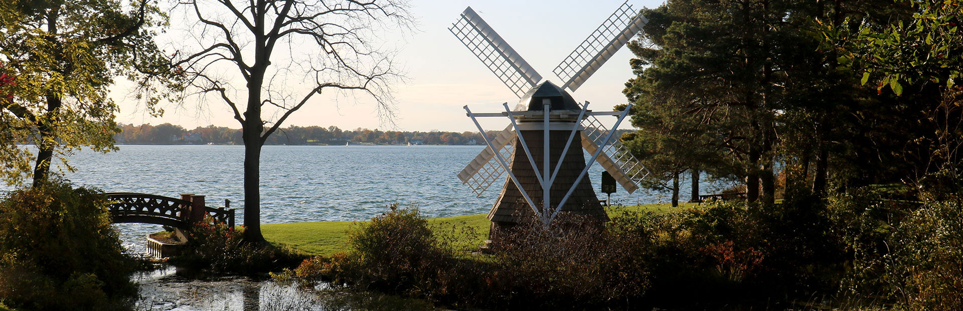 View of Gull Lake from Windmill Island, with the historic KBS windmill and foot bridge in the foreground.