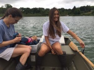 Blog author Olivia Porth sampling phytoplankton and water in a lake near KBS.