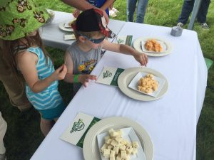 Children Sampling cheese at the Kellogg Farm Pasture Dairy Open House