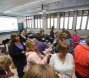 Middle & high school teachers participate in a learning activity about greenhouse gases