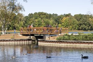 Sanctuary guests walking on the Thomas Bridge at the Bird Sanctuary