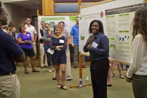 Summer students share their research experience with symposium guests