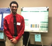 Student presenting research poster