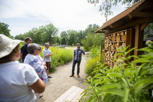 Graduate student Sean Griffin explains the bee condo