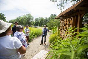 Graduate student Sean Griffin explains the bee condo