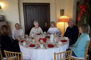Volunteers enjoy a special tea service at the Manor Houe