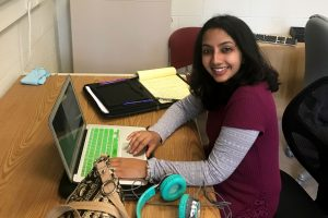 Akshata Rudrapatna works on her laptop in an office at KBS.
