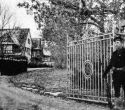A guard stands at the gate of the W.K. Kellogg estate during the World War II years.