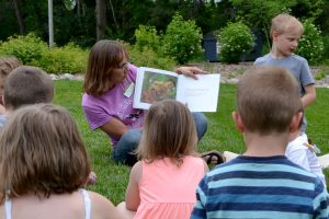 Misty Klotz reads to a group of children at a Wild Wednesdays event.