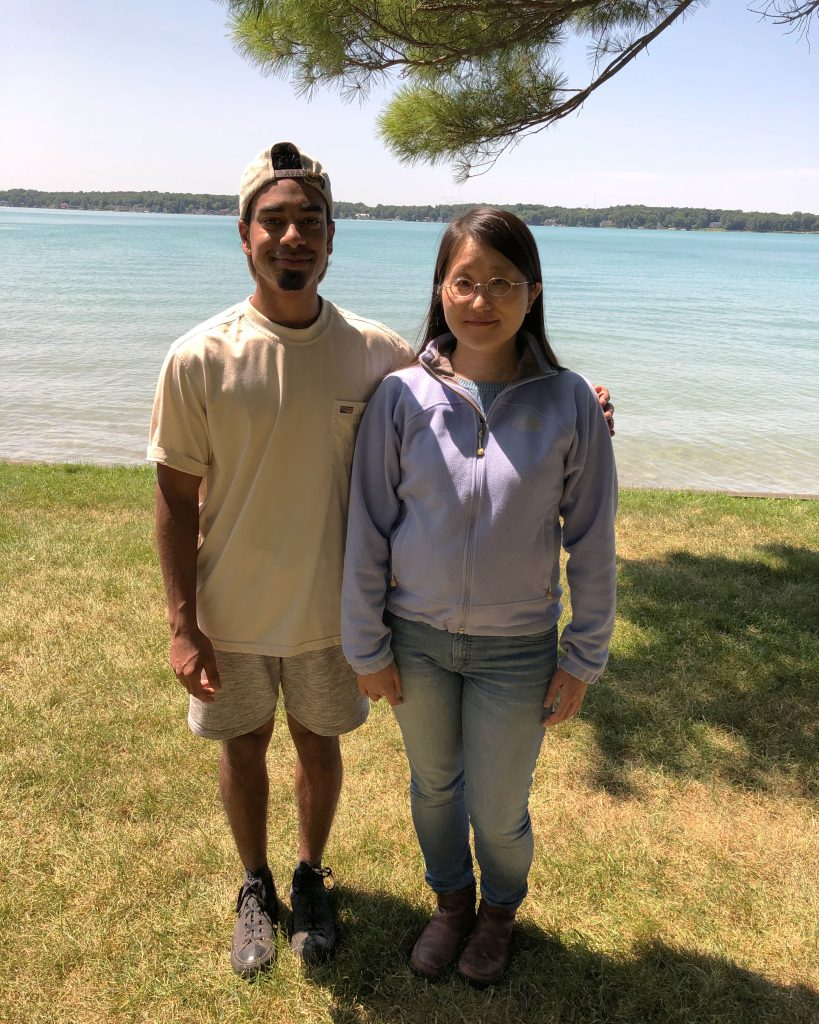 Undergraduate Brandon D'Souza poses with his mentor, Dr. Hsunyi Hsieh with Gull Lake in the background.