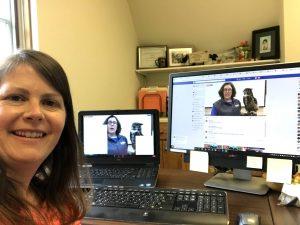 Kara Haas selfie, with dual screen showing bird of prey program