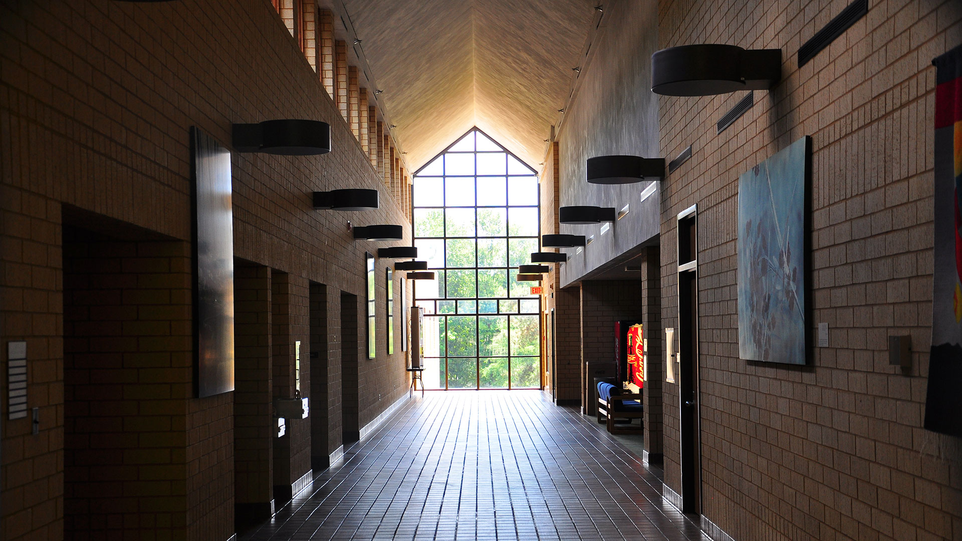 Backlit photo of the main hallway in the KBS Academic Building.
