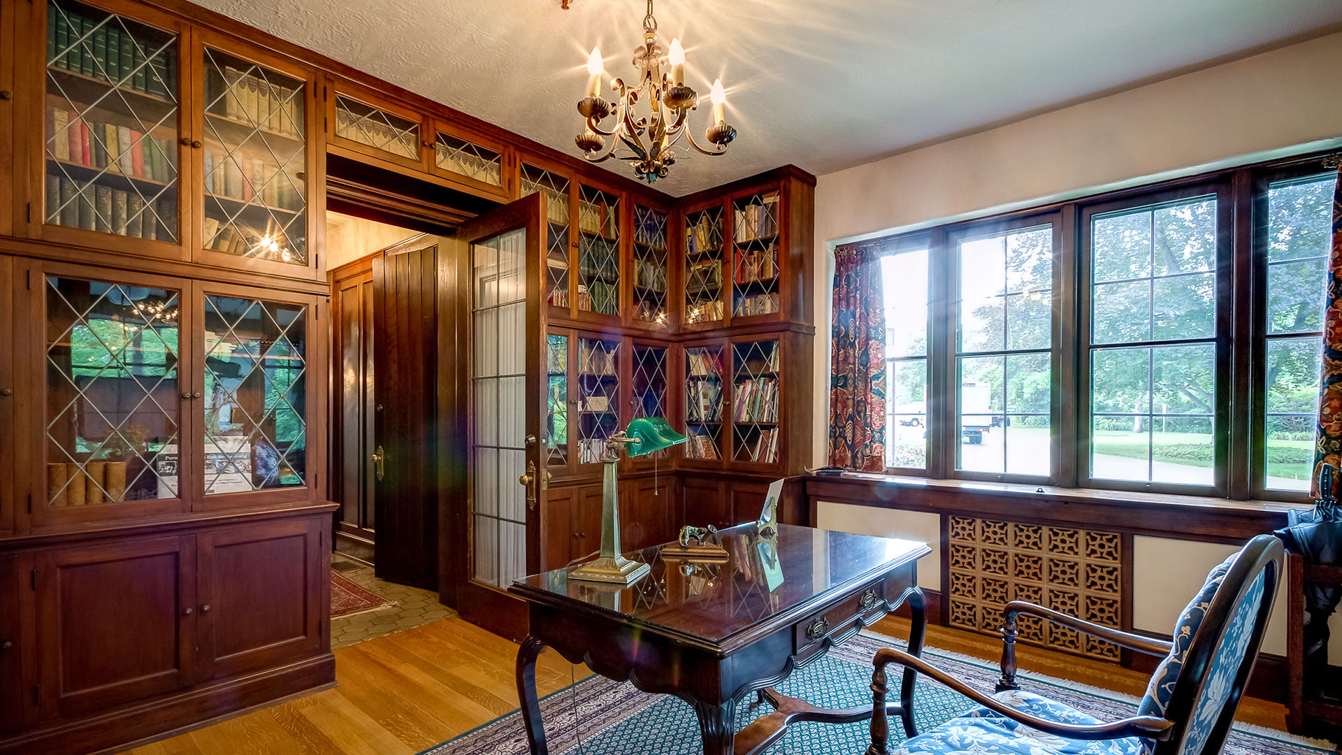 The library in the Kellogg Manor House, featuring wooden built-in bookshelves.