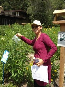 Joelyn de Lima showing transpiration via a leaf trapped in a plastic bag in the Kellogg Bird Sanctuary garden
