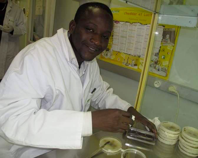 Ousseini Issaka Salia smiles while working in a lab.