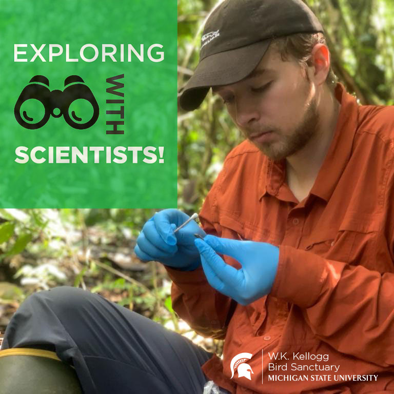 Kyle Jaynes sits in a forested area, looking down at small object in his hands. Text overlay reads Exploring with Scientists.