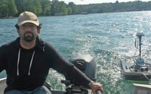 Then-graduate student Ammar Safaie navigates Gull Lake in a motorboat while measuring depths at various points in the lake. Photo credit: Phani Mantha
